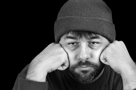 Dramatic black and white portrait of a man in despair photo