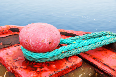 mooring: Sea concept : red mooring bollard for very large boat over ocean