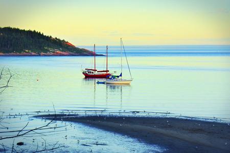 anchored: Dramatic hdr, anchored sailboats in a bay at sunset, beautiful nature