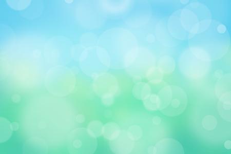 Luchtige achtergrond met bokeh en andere verlichting effect op blauw, groen, geel, turquoise achtergrond, natuur concept Stockfoto
