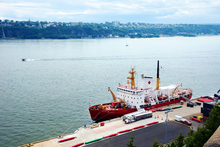 trafic: CANADA, QUEBEC CITY- JULY 20, 2014: Canadian coast guard Des Groseillers vessel  on the St.Lawrence, docked in Quebec city. The Coast guard is responsible for 2.3 million square nautical miles (8 million km2).