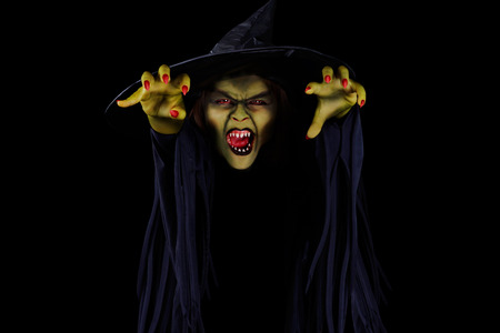 demented: Scary wicked witch trying to catch viewer, Halloween concept