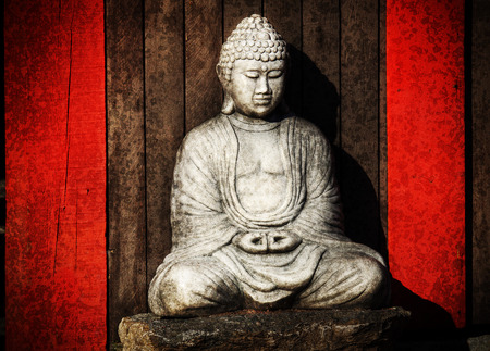 meaningful: Dramatic vintage grungy buddha statue, grainy texture and vignetting effects