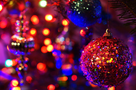 Beautiful and colorful lights and Christmas ornaments in a fir tree