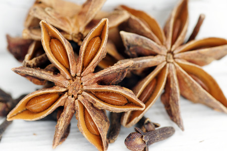 Star anise spice over old white painted wood, detail macro Imagens