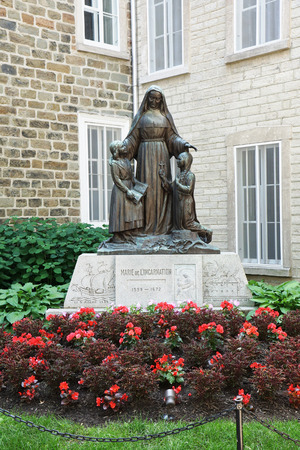 incarnation: QUEBEC CITY, CANADA - JULY, 20: Statue of Marie of the incarnation in historical Old Quebec on July 20, 2014. She founded the first school for females in America, in 1642.