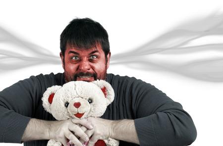 strangling: Man strangling teddy bear, anger management, frustration or head exploding concept