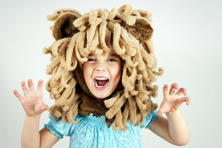costumes: Little girl with lion mane costume roaring