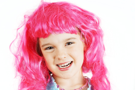 Cute little girl with bright pink wig