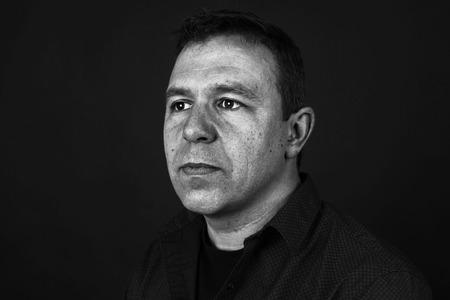 sullen: Dramatic portrait of a sullen man in black and white