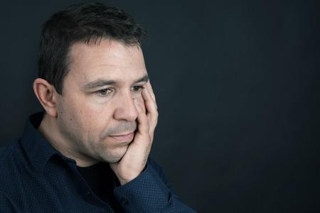 mental health: Desaturated portrait of a sad or upset man