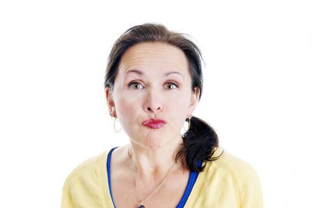 puckering lips: Woman making sour puss, bitter, unhappy face Stock Photo