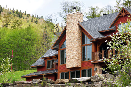 Beautiful luxurious house or cottage in the hills spring time 스톡 콘텐츠