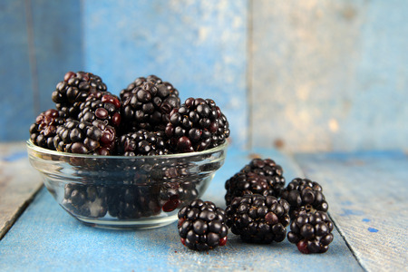 Delicious blackberries, wild fruit over old blue wood Reklamní fotografie