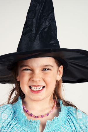 pointy: Portrait of a cute little witch being scary