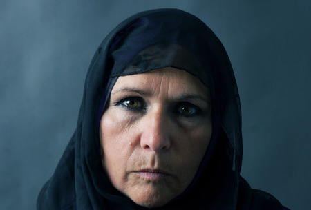 Dramatic sombre portrait of a muslim woman Standard-Bild