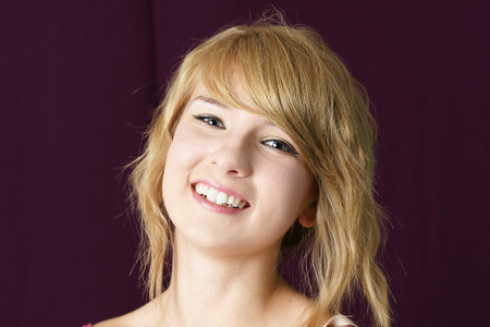 demure: Portrait of a natural, young beautiful blond girl smiling