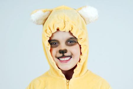 growling: Cute little girl in teddy bear costume making, Halloween concept Stock Photo