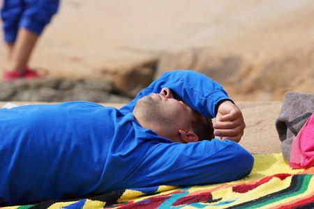 Man relaxing and taking a nap outside in the sun Stock fotó