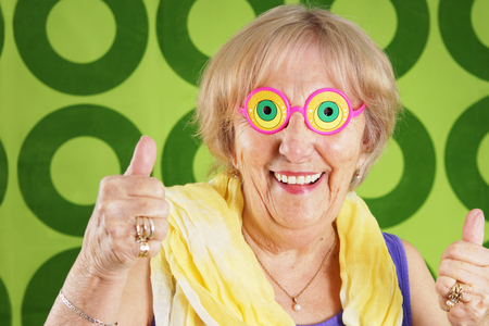Humorous cool grandmother with crazy glasses Stock fotó