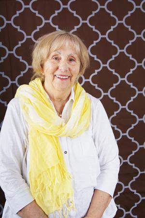 Happy senior woman with scarf
