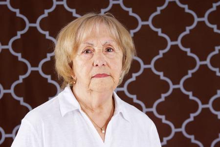 Portrait of serious blond senior woman Stock fotó