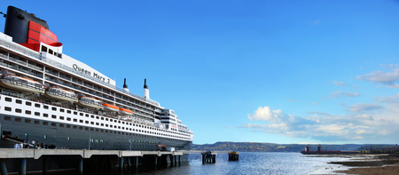 SAGUENAY, QUEBEC, CANADA - OCTOBER 8, 2016: First visit of the Queen Mary 2 cruise ship at the Bagotville wharf on the Saguenay fjord on October 8, 2016. The Saguenay flows into the St.Lawrence seaway. Editorial