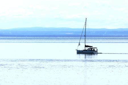 Artistic rendering of a sail boat on calm sea Reklamní fotografie