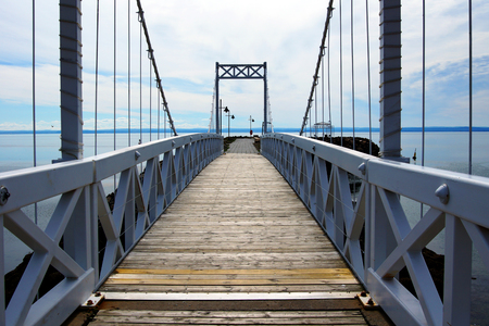 Perspective view cable and wood bridge of a small coastal town