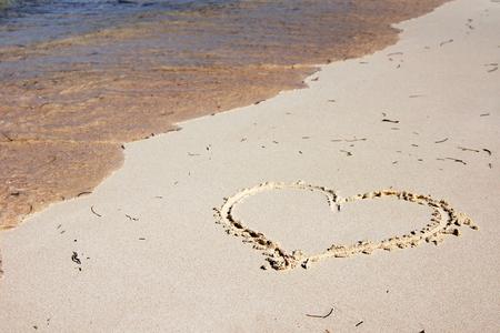 Heart drawn on the sandy beach Stock fotó