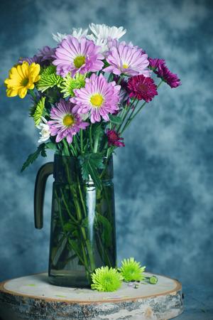 Mum flowers in water pitcher,still life, light effect