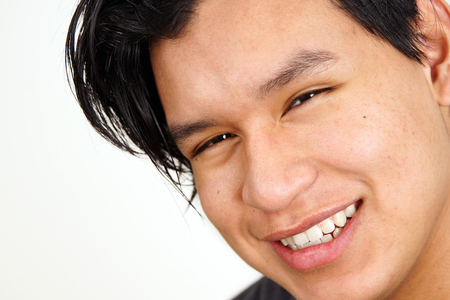 Portrait of cute young latino man smiling and looking Stock fotó