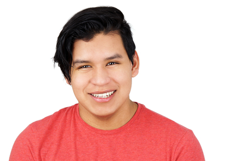 Cute hispanic teenager young man, looking and smiling isolated on white   Stock fotó