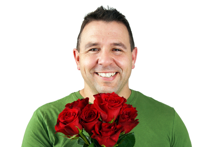 Romantic man with bouquet of red roses