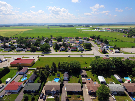 Aerial view of small Canadian town, agricultural fields