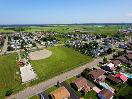 Aerial of sport fields in small town with copy space Stock fotó