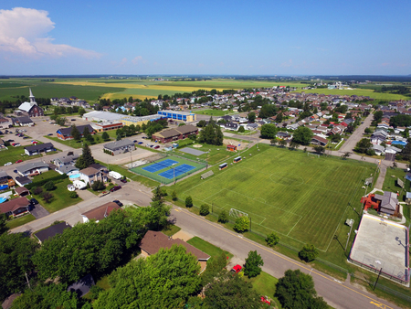 Aerial view of small Canadian town, soccer field, tennis and basketball courts