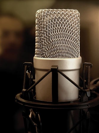 Shock-mounted condenser microphone in a sound studio. Stock Photo