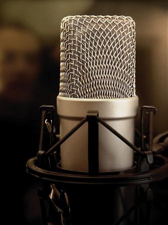 condenser: Shock-mounted condenser microphone in a sound studio. Stock Photo