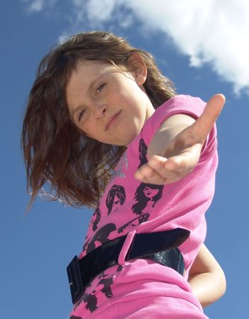 lend: Low angle shot of young girl with hand extended toward camera