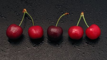 Five cherries in a row. Stock Photo