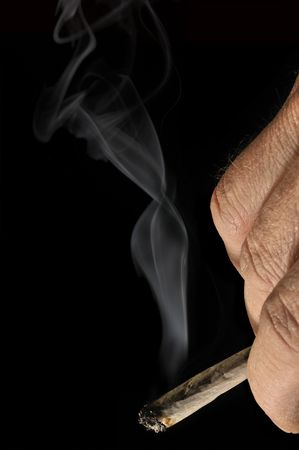 reefer: Hand rolled cigarette and smoke