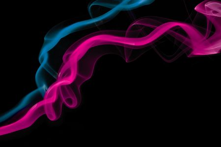 Pink and blue smoke trails side by side. photo