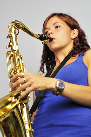 Pretty girl playing saxophone