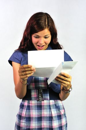 read news: Girl reading a letter with great news. Stock Photo