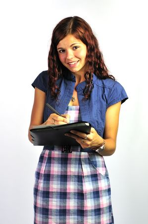 Smiling girl taking notes. Stock Photo
