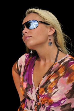 Blonde girl with aviator style sunglasses.