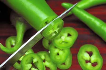 slicing: Slicing Green Chillies Stock Photo