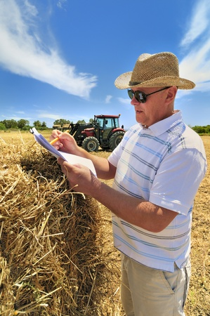 A man deals with paperwork on a farm