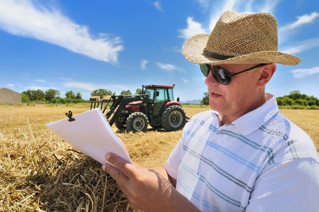 A man deals with farm documentation  Stock Photo